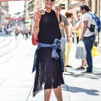 WEAR THIS: WHITE SNEAKERS AND BLACK PLEATED DRESS | People & Styles - Fashion, Style & What to Wear Now