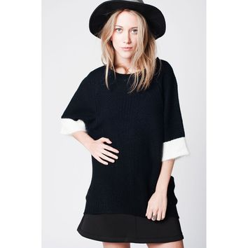 Black sweater in angora mix with 3/4 sleeves and white contrast trim