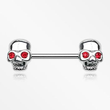 A Pair of Red Eyed Sparkle Skull Nipple Barbell