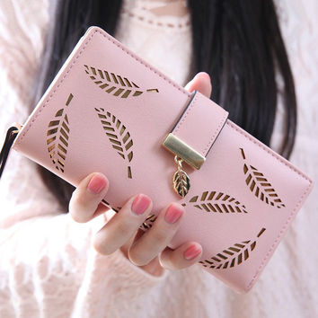 Wallet With Leaves and Cut Out Design