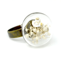 White baby's breath in hand blown glass adjustable ring.