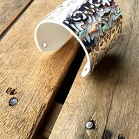 Our In The Moment Cuff Bracelet is a must have for your jewelry box! It's a cuff bracelet with a unique pattern that allows the leather to peek through.