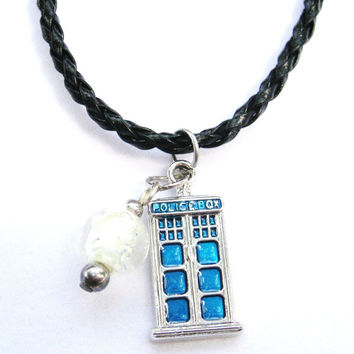 Inspired byStarry night tinypolicebox necklace , with glow in the dark glass bead .inspired by the Van Gogh episode