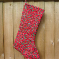 Red Christmas Stocking with delicate holly printed on the fabric, lined with plain cream fabric