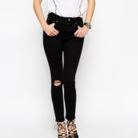 ASOS Ridley Skinny Ankle Grazer Jeans in Black with Shredded Knee at asos.com
