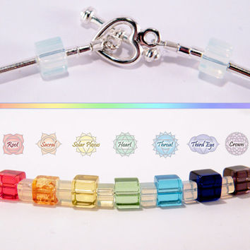 Chakra Necklace .. rainbow and opalite glass beads, silver-plated tube beads and a sweet tiny heart toggle clasp