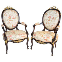 A Fine Pair Of French Salon Chairs In Rosewood With Cast Gilt Metal Mounts.