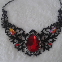 red rhinestone black  hollow filigree  statement  necklace