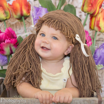Cabbage Patch WIg!! These come in EVERY size and a variety of COLORS