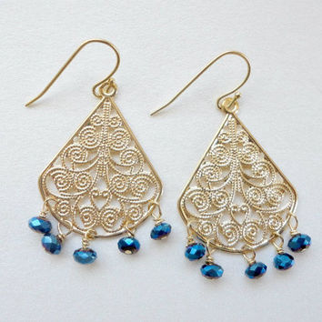Gold chandelier earrings with blue glass beads