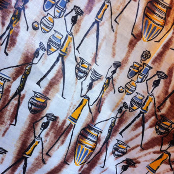 African Wax Print Fabric by the HALF YARD.African Figures/Drums/Baskets in Yellow, Tan, Brown, and Black.
