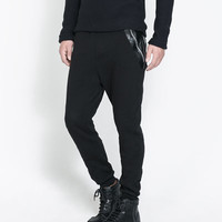TROUSERS WITH FAUX LEATHER PATCHES - Trousers - Man   ZARA United States