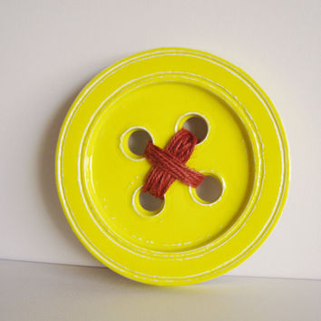 Ceramic button sculpture, stoneware clay, yellow ceramic button wall hanging with burnt orange yarn