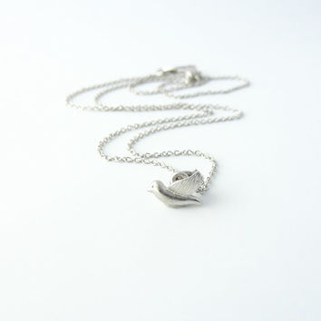 White gold charm necklace | Tiny dove charm, Bird necklace, Petite jewelry