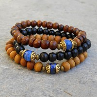 Compassion - Genuine Lapis Lazuli Guru Bead Sandalwood, Ebony, and Wood Beaded Set Of 3 Mala Bracelets