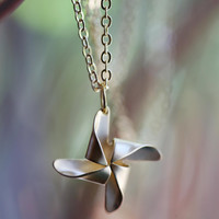 Pinwheel necklace. Silver or gold.