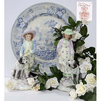 Pair Vintage Parisian French Country Figurines Boy & Girl w/ Dogs Hand Painted Pastel Colors