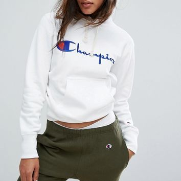 Champion Oversized Boyfriend Hoodie With Script Logo at asos.com