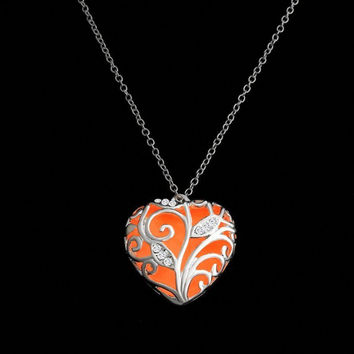 Orange glow in the dark silver heart pendant necklace, key ring, or rear view mirror hanger