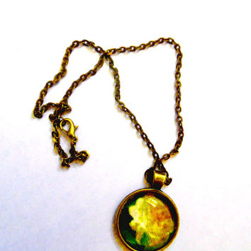 Buttercup/flower/yellow/green/fabric/bronze/circular carbochon necklace/pendant