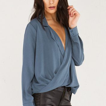 AKIRA Plunging Deep V Collared Shirt With Draped Wrap Front Cropped Front Hem and Long Shirttail Back Hem in Grey
