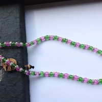 Pink and green glass beaded necklace with rhinestone spacer beads.