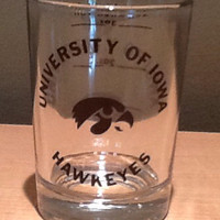 Vintage collectible souvenir 4 ounce shot glass from the University of Iowa Hawkeyes. Markings for 1 oz, 2 oz, 3 oz, 4 oz when full.