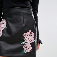 ASOS PETITE Leather Look Mini Skirt with Embroidery Detail at asos.com