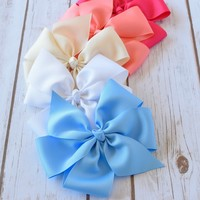 Extra large 6.5 pinwheel hair bows on your choice of alligator clip with no slip grip or barrette. Your Final Touch Hair Accessories