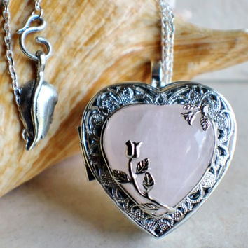 Music box locket in silver tone with rose quartz crystal heart.