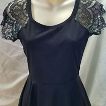Almost Famous  Womens Juniors Top Size S Black with lace sleeves