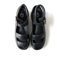 Vintage black leather sandals. Cut out wedges. Leather platforms. Strappy gladiator sandals. Peep toes. womens size 6.5
