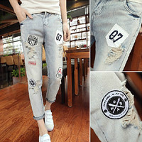 Patch and Ripped Designer Jeans