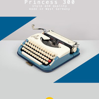 1960's Princess 300 Typewriter. Ivory & blue. Refurbished and fully functional. Ultra portable. With Case. *REFURBISHED TO ORDER*