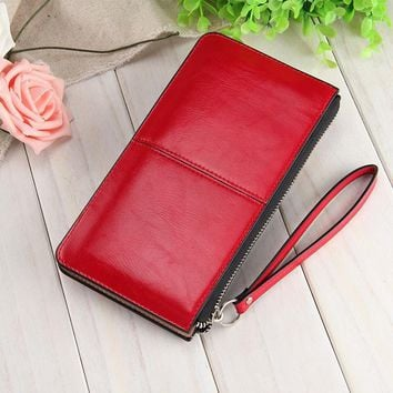 Women famous brand Oil wax leather zipper clutch wallet female candy color burglar robbed purse lady Multi-function phone bag