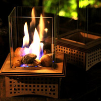 Tabletop Glass Fireplace, This indoor/outdoor lantern can add light to your patio and roast S'mores, too!