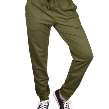 Athletic knit pants featuring a drawstring waist, slant front pockets, and banded ankle cuffs