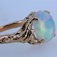 14k rose gold opal tree ring holding up the moon  NYC Blue Bayer Design