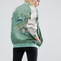 ASOS Reversible Bomber Jacket With Embroidery at asos.com