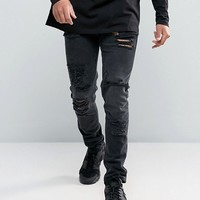 ASOS Skinny Jeans in 12.5oz With Mega Rips In Washed Black at asos.com