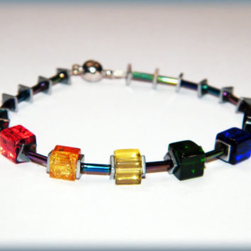 IronPride bracelet.. Gay Pride bracelet with rainbow glass cube beads, haematite beads, rainbow sheen glass tube beads and a magnetic clasp