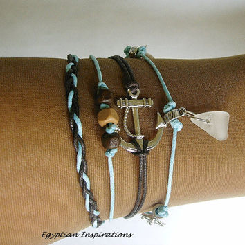 Beach glass charm bracelet with anchor and nautical charms. Sea glass jewelry.
