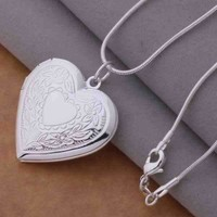 ON SALE - Floral Design Stamped Sterling Silver Heart Locket Necklace