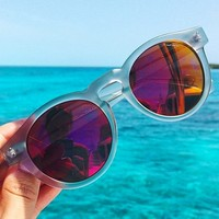 Komono Clement Sunglasses in Frost/Red Mirror