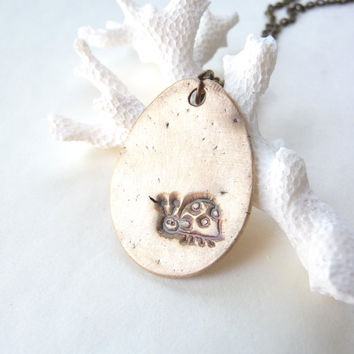 Ladybug pendant hand stamped from pure bronze