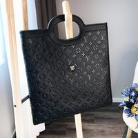 LV Louis vuitton fashion casual black embossed ladies bulky thin handbag