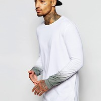 ASOS Super Longline Long Sleeve T-shirt With Dip Dye Sleeves at asos.com