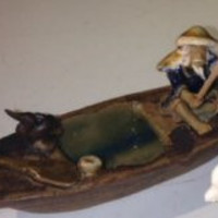 Ceramic FigurineFisherman On A Boat Fishing With Duck
