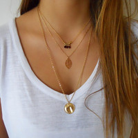Layered Gold Necklace Set - Leaf pendant with a Red and Gold Bead Design