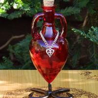 LOVE Ancient Magic Potion Bottle Vessel with Metal Stand - Scarlet Red with Silver Heart Charm . Pagan Wicca WItchcraft
